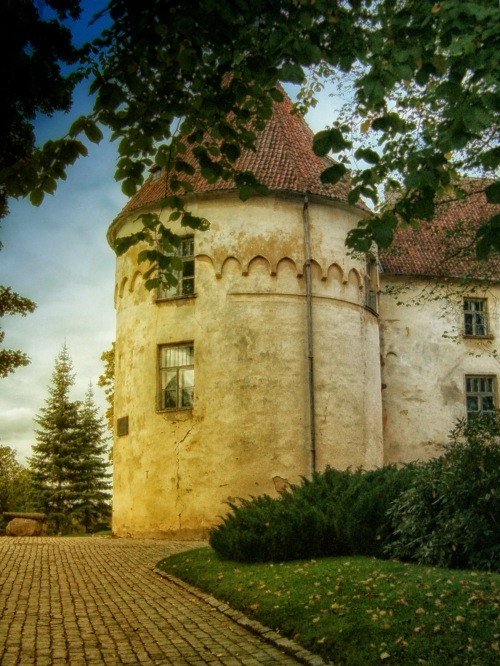 Jaunpils Castle in late afternoon sunlight.